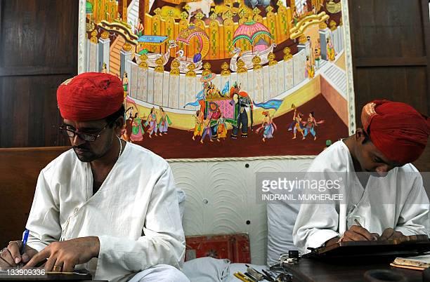 In this March 22 2010 photograph Lehiyawriter artists replicate Jain scripture on jute paper at a workshop in Mumbai Some 20odd lehiyas in...