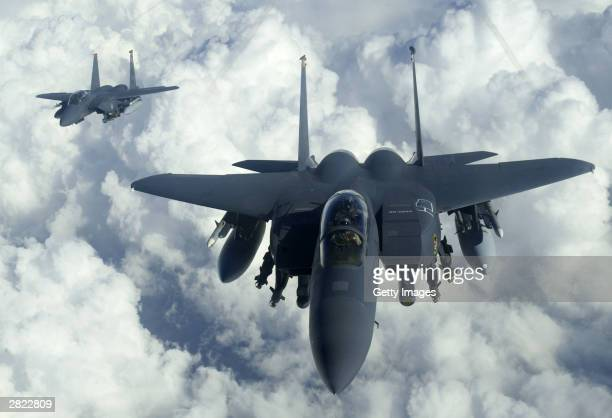 In this military handout photo F15E Strike Eagles from Mountain Home Air Force Base Idaho soar over Iraq on December 18 2003 in support of Operation...