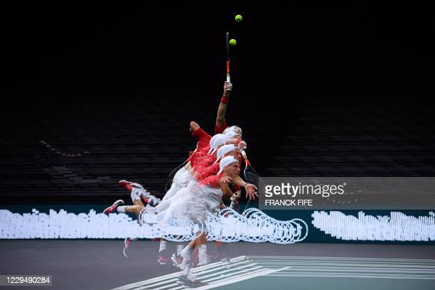 In this multi exposure picture Argentina's Diego Schwartzman returns the ball to Russia's Daniil Medvedev during their men's singles quarter-final...