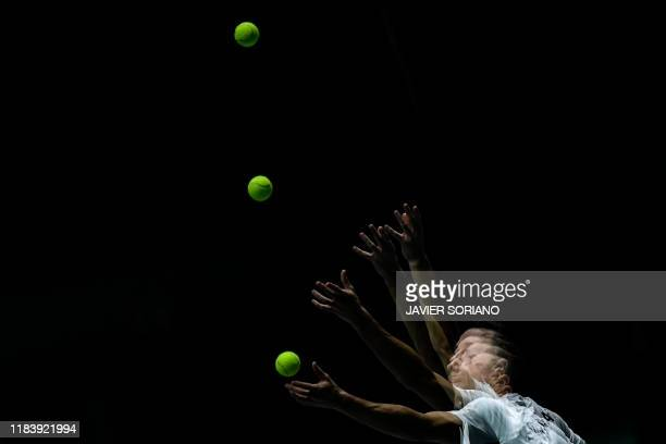 In this multi exposure picture Germany's Philipp Kohlschreiber serves the ball to Great Britain's Kyle Edmund during the singles quarterfinal tennis...