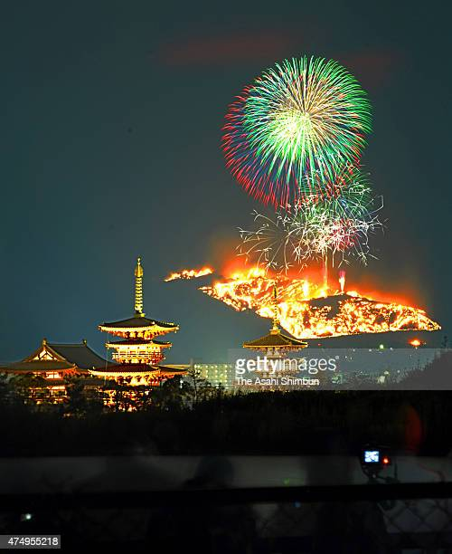 In this multiple exposure image fireworks are seen during the Yamayaki festival at Wakakusa yama hill on January 22 2011 in Nara Japan