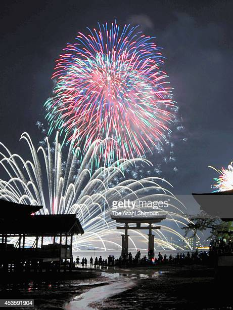 In this multiple exposure image fireworks explode during the Miyajima Fireworks Festival at Itsukushima Shrine on August 13 2014 in Hatsukaichi...