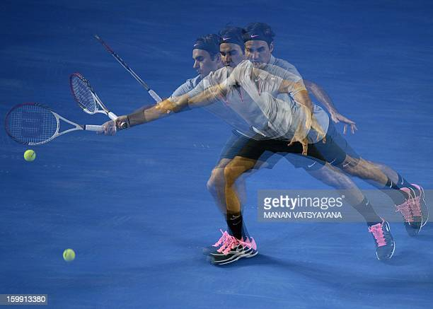 In this multiple exposure photograph Switzerland's Roger Federer hits a return against France's JoWilfried Tsonga during their men's singles match on...
