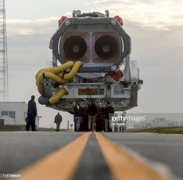 In this NASA handout A Northrop Grumman Antares rocket is seen as it rolls out to Pad0A Monday April 15 2019 at NASA's Wallops Flight Facility in...