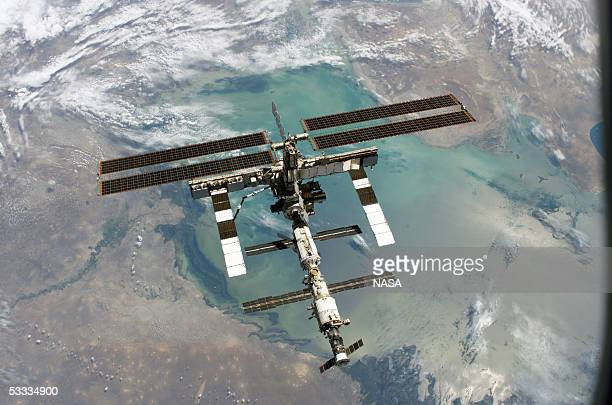 In this NASA handout, back dropped by Earth, the International Space Station is seen from the Space Shuttle Discovery following the undocking of the...