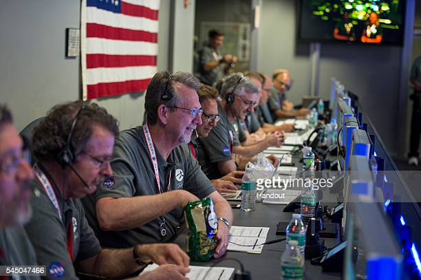 In this NASA handout Dr Jim Green Planetary Science Division Director NASA is seen in the mission control room awaiting communication from Juno that...