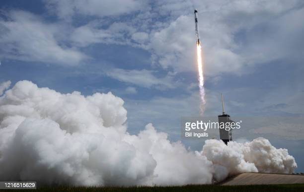 In this NASA handout image, A SpaceX Falcon 9 rocket carrying the company's Crew Dragon spacecraft is launched from Launch Complex 39A on NASAs...