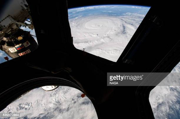 In this NASA handout image, Hurricane Harvey from the cupola module aboard the International Space Station as it intensified on its way toward the...