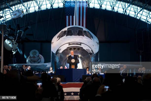 In this NASA handout image US Vice President Mike Pence delivers opening remarks during the National Space Council's first meeting at the Smithsonian...