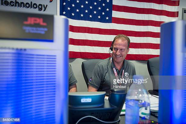 In this NASA handout Rick Nybakken Juno project manager Jet Propulsion Laboratory is seen in the mission control room awaiting communication from...