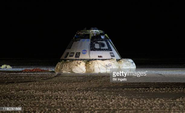 In this NASA handout, the Boeing CST-100 Starliner spacecraft is seen after it landed in White Sands, New Mexico, Sunday, Dec. 22, 2019. The landing...