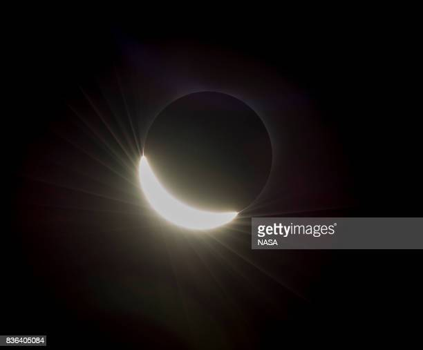 In this NASA handout the last glimmer of the sun is seen as the moon makes its final move over the sun during the total solar eclipse on August 21...