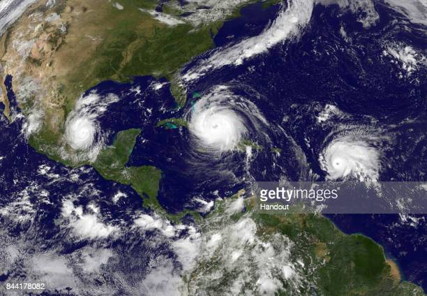 In this NASA/NOAA handout image, NOAA's GOES satellite shows Hurricane Irma in the Caribbean Sea, Tropical Storm Jose in the Atlantic Ocean and...