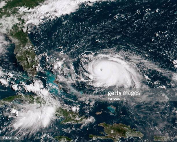In this NOAA GOES-East satellite handout image, Hurricane Dorian, now a Cat. 4 storm, tracks towards the Florida coast taken at 13:40Z August 31,...