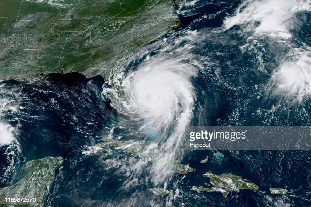 In this NOAA GOES-East satellite handout image, Hurricane Dorian, now a Cat. 2 storm, inches northwest away from the Bahamas on September 3, 2019 in...