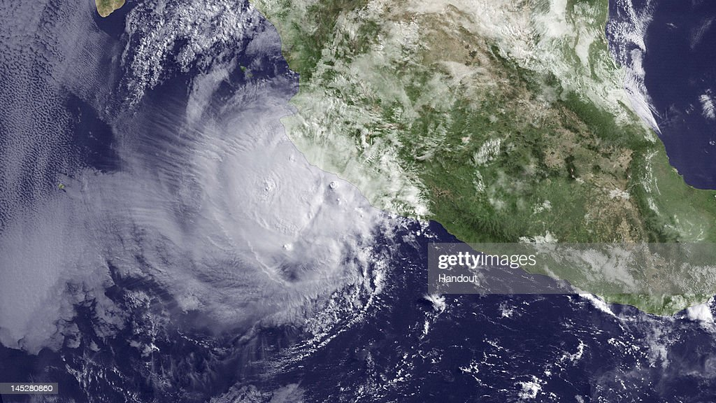 In this NOAA GOES-East satellite handout photo provided by NOAA, Hurricane Bud is seen May 25, 2012 110 miles off the coast of Mexico. The National Hurricane Center predicts landfall will occur around 5am PDT on Saturday, May 26 as a tropical storm. Bud weakened from a Category 3 to Category 2 hurricane overnight.