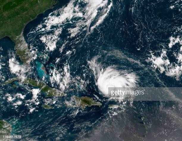In this NOAA GOES-East satellite image, Hurricane Dorian leaves the Caribbean Sea and tracks towards the Florida coast taken at 14:20 UTC August 29,...