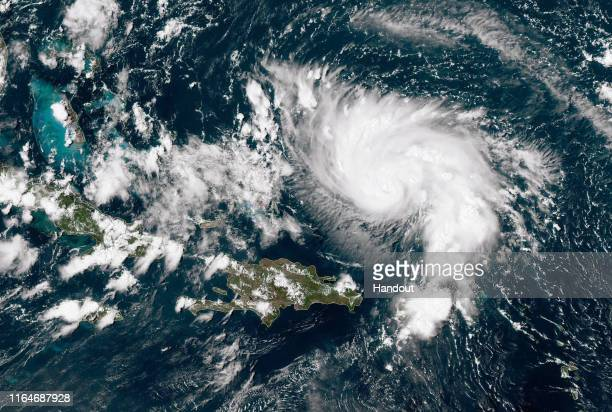 In this NOAA GOESEast satellite image Hurricane Dorian leaves the Caribbean Sea and tracks towards the Florida coast taken at 1840Z August 29 2019 in...