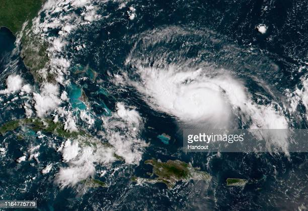 In this NOAA GOES-East satellite image, Hurricane Dorian, now a Cat. 2 storm with maximum sustained winds of 110 mph, gains strength as it tracks...