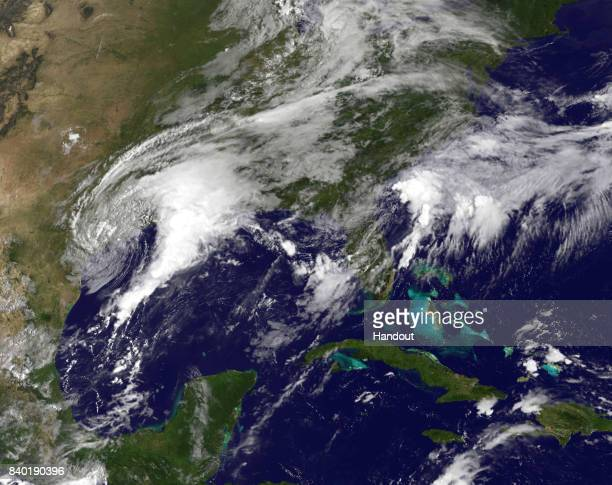 In this NOAA handout image NOAA's GOES East satellite capture of Tropical Storm Harvey as it churns 1345 UTC on August 28 2017 on the midTexas coast...