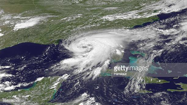 In this NOAA handout image taken by the GOES East satellite at 1915 UTC Hurricane Hermine approaches the Gulf Coast of Florida on September 1 2016 As...