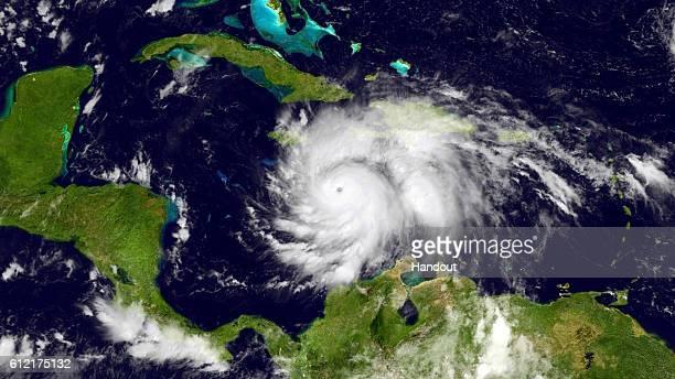 In this NOAA handout image taken by the GOES satellite at 1315 UTC shows Hurricane Matthew in the Caribbean Sea heading towards Jamacia Haiti and...