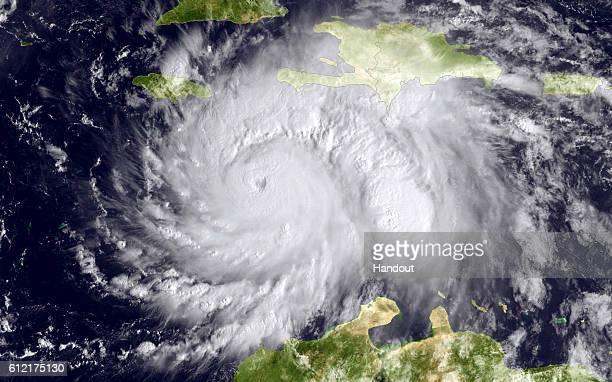 In this NOAA handout image taken by the GOES satellite at 1620 UTC shows Hurricane Matthew in the Caribbean Sea heading towards Jamacia Haiti and...