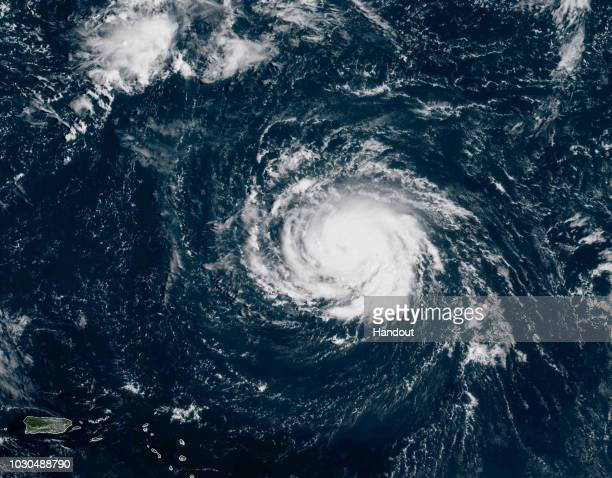 In this NOAA satellite handout image shows Hurricane Florence as it travels west and gains strength in the Atlantic Ocean southeast of Bermuda on...