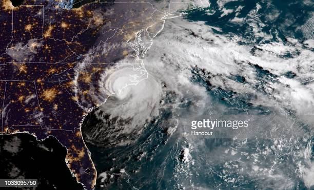 In this NOAA satellite handout image shows Hurricane Florence as it made landfall near Wrightsville Beach North Carolina on September 14 2018 The...