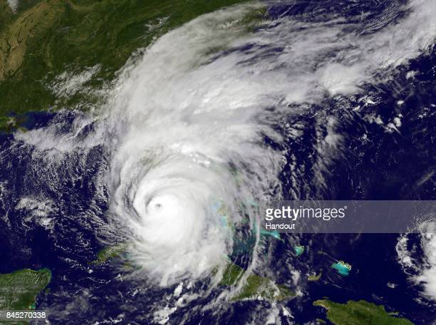 In this NOAANASA GOES Project handout image GOES satellite shows Hurricane Irma as it makes landfall on the Florida coast as a category 4 storm taken...