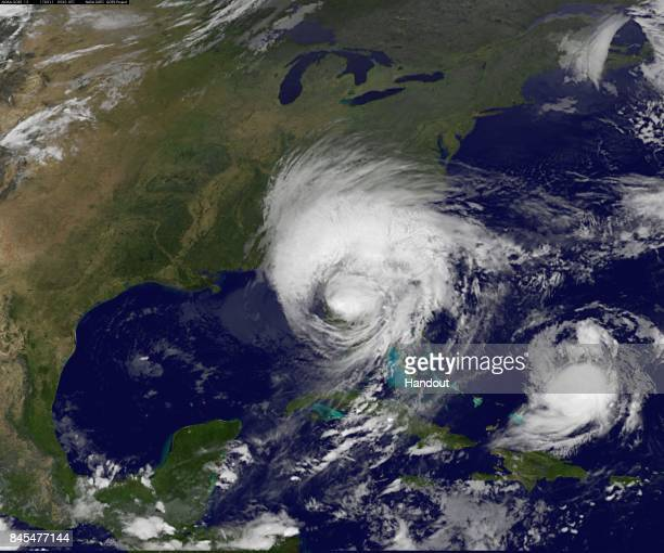 In this NOAANASA GOES Project handout image GOES satellite shows Hurricane Irma as it moves on the Florida coast as Tropical Storm Jose moves west in...