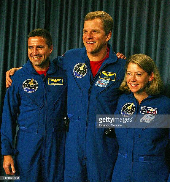 In this November 7 2007 file photograph astronauts including pilot George Zamka from left Scott Parazynski and commander Pamela Melroy arm in arm...