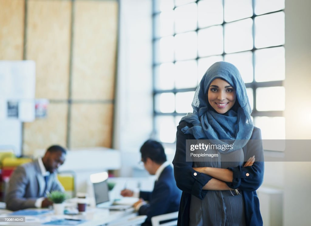 In this office, hard work is no stranger to us : Stock Photo