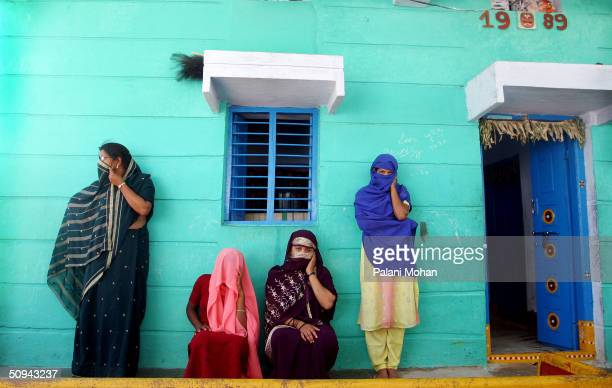 In this particular community northeast of the state capital Hyderabad sex workers wait for customers April 16 2004 in the Indian state of Andhra...