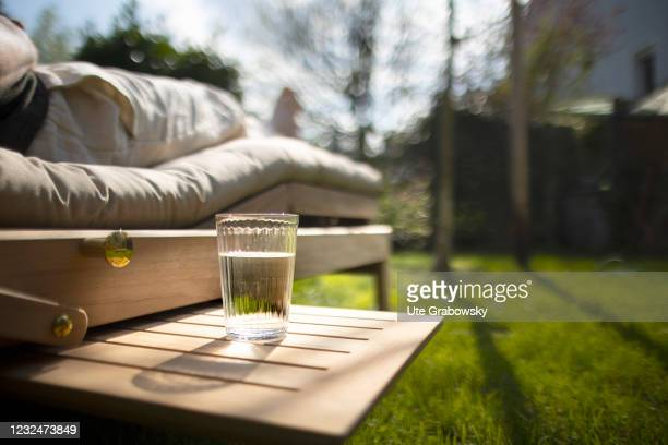 In this photo a glas of water stands next to a lounger illustration on April 20, 2021 in Bonn, Germany.