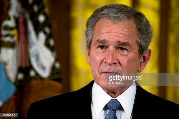In this photo by the US Navy Tears stream down the face of US President George W Bush during an East Room ceremony to present a posthumous Medal of...