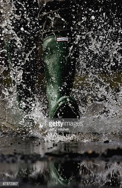 In this photo illistration a man is seen wearing a pair of Hunter wellington boots April 20 Dumfries in Scotland.The iconic wellington boot company...