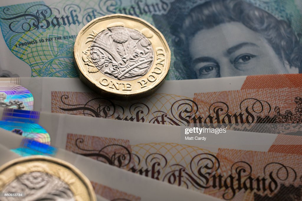 In this photo illustration, £1 coins are seen with the new £10 note on October 13, 2017 in Bath, England. Currency experts have warned that as the uncertainty surrounding Brexit continues, the value of the British pound, which has remained depressed against the US dollar and the euro since the UK voted to leave in the EU referendum, is likely to fluctuate.