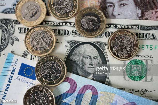 In this photo illustration, £1 coins are seen with the new £10 note alongside euro notes and US dollar bills on October 13, 2017 in Bath, England....