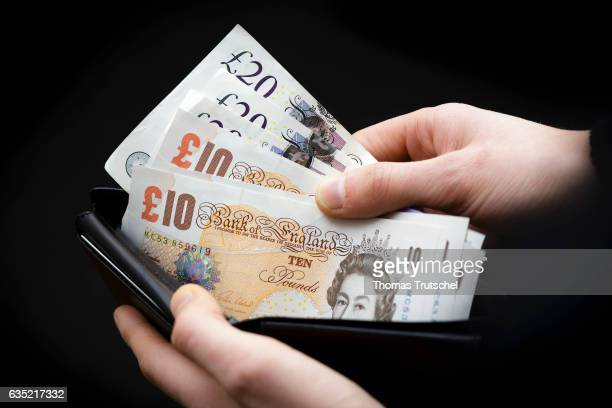 In this Photo Illustration £ 10 and £ 20 pound sterling bills stuck in a wallet on February 13 2017 in Berlin Germany