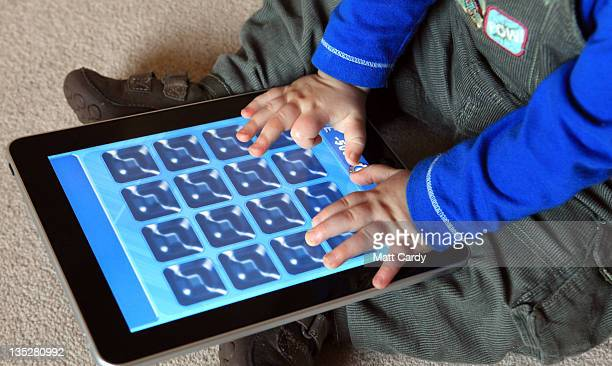 In this photo illustration 13month old Zac Cardy uses a iPad at his home on November 25 2011 in Glastonbury United Kingdom Tablet computers have...