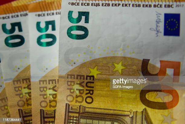 In this photo illustration 50 Euro banknotes seen displayed