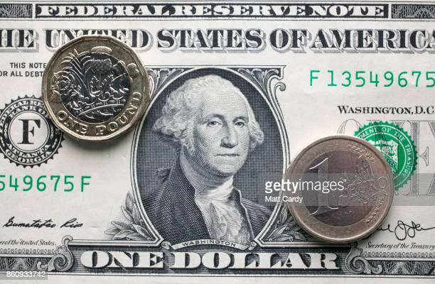 In this photo illustration a £1 coin is seen a US dollar bill and 1 euro coin on October 13 2017 in Bath England Currency experts have warned that as...