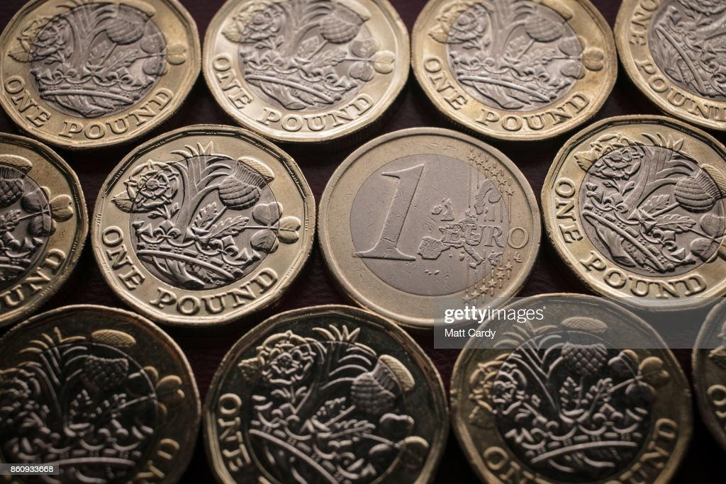 In this photo illustration, a £1 coins are seen with a Û1 euro coin on October 13, 2017 in Bath, England. Currency experts have warned that as the uncertainty surrounding Brexit continues, the value of the British pound, which has remained depressed against the US dollar and the euro since the UK voted to leave in the EU referendum, is likely to fluctuate.