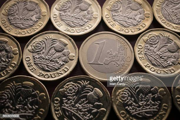 In this photo illustration a £1 coins are seen with a Û1 euro coin on October 13 2017 in Bath England Currency experts have warned that as the...