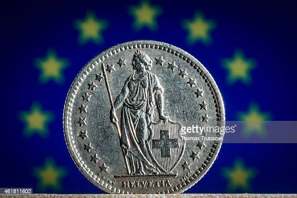In this photo illustration a 2 Swiss Franc Coin stands in front of the flag of European Union on January 20 2015 in Berlin Germany