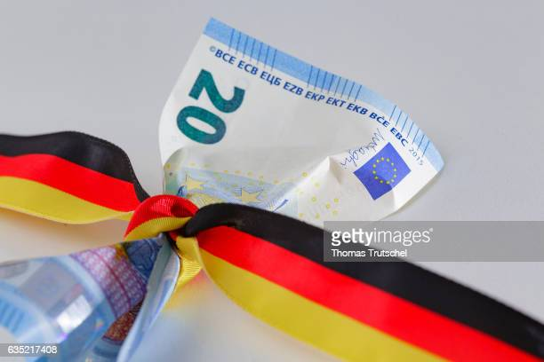 In this Photo Illustration a 20 Euro bill is wrapped round with a ribbon in the national colors of Germany on February 14 2017 in Berlin Germany