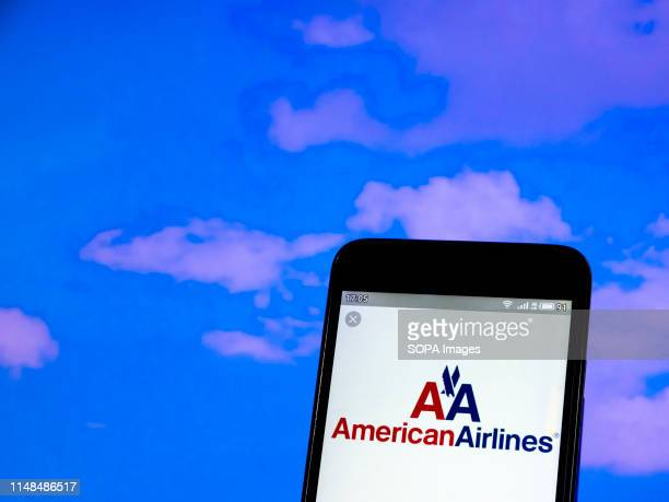 In this photo illustration a American Airlines logo seen displayed on a smartphone.