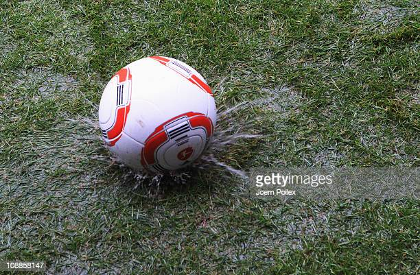 In this photo illustration a ball drops on the soaked pitch at the Imtech Arena on February 6 2011 in Hamburg Germany The Bundesliga match between...