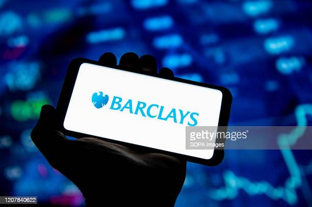 In this photo illustration a Barclays Bank logo seen displayed on a smartphone.